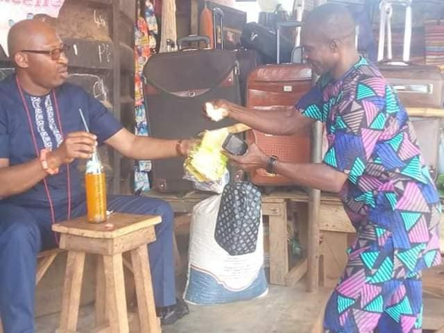 Hon Patrick Obahiangbon spotted eating a loaf of bread by the road side in Edo State (Photos)