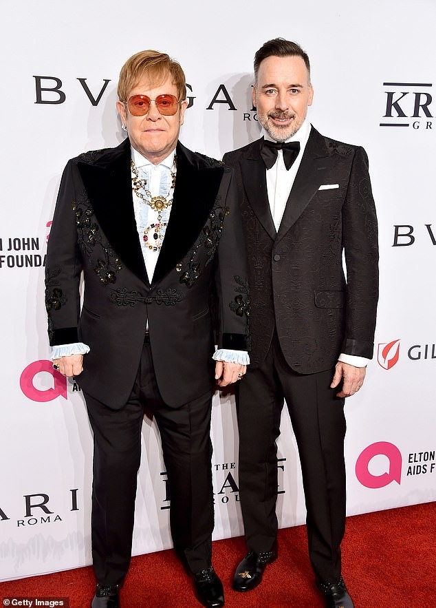 Singer Elton John rocks stylish suit as he steps out with husband David Furnish for an event in New York (Photos)