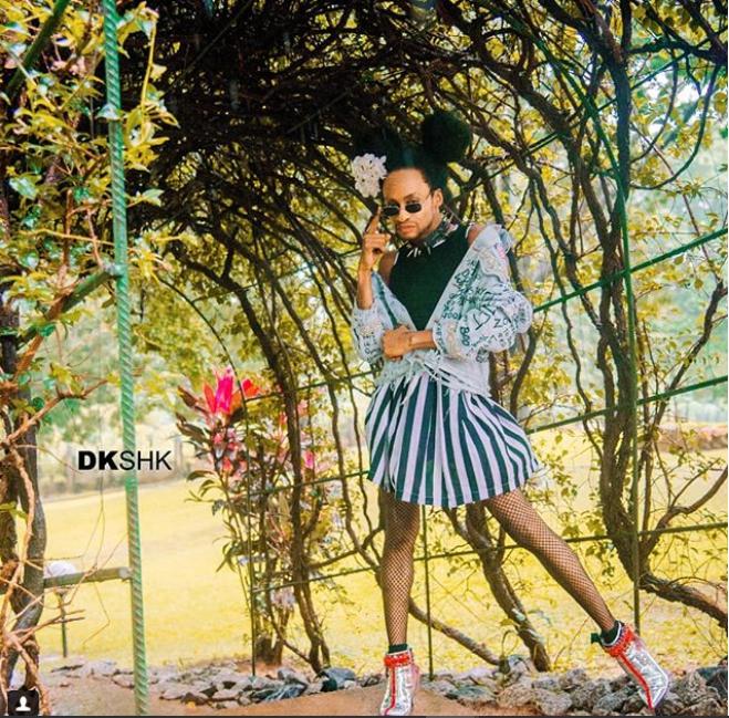 Denrele Edun rocks mini-skirt and sleeveless top in new photos