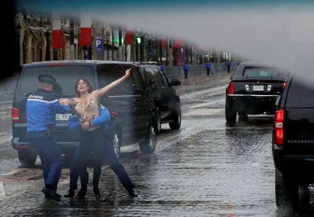 Photos &Video: Topless woman runs at President Trump
