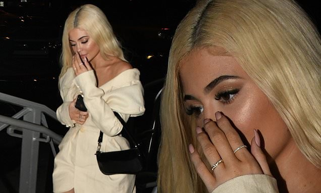 Kylie Jenner wears a diamond-encrusted ring on her wedding finger for dinner with Travis Scott ?(Photos)