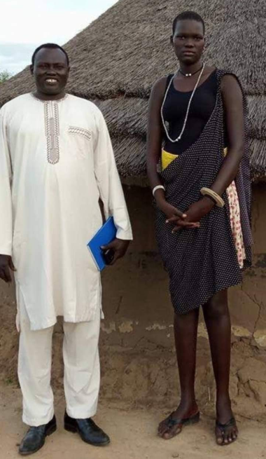 Underage bride looks downcast on her wedding to much older man who gave 500 cows and 3 V8-engine cars to marry her (photos)