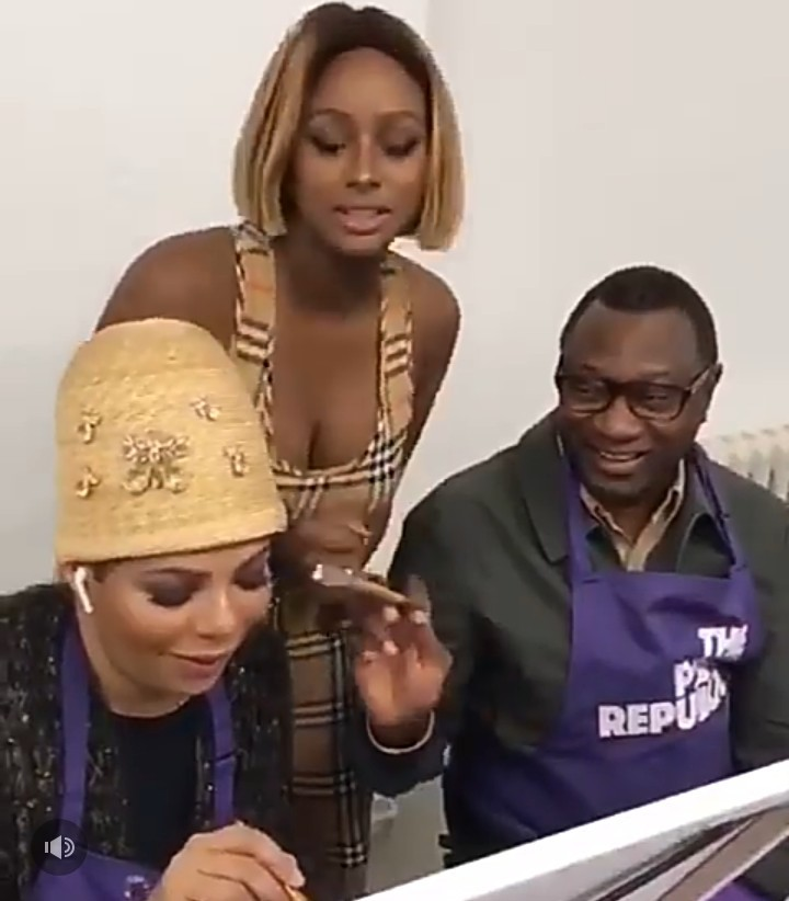 Adorable image of Femi Otedola and wife Nana drawing daughter DJ Cuppy on her birthday