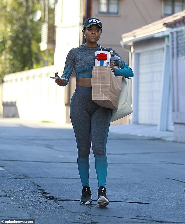 Gabrielle Union flaunts her curves as she
