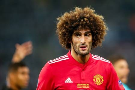 You won't believe what Man.U star Marouane Fellaini now looks like after cutting off his trademark curly locks (Photos)