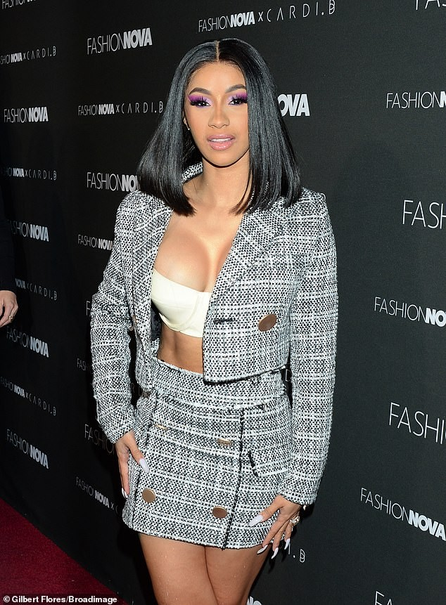 Cardi B puts on busty display in white bra and tweed jacket as she steps out for an event (Photos)