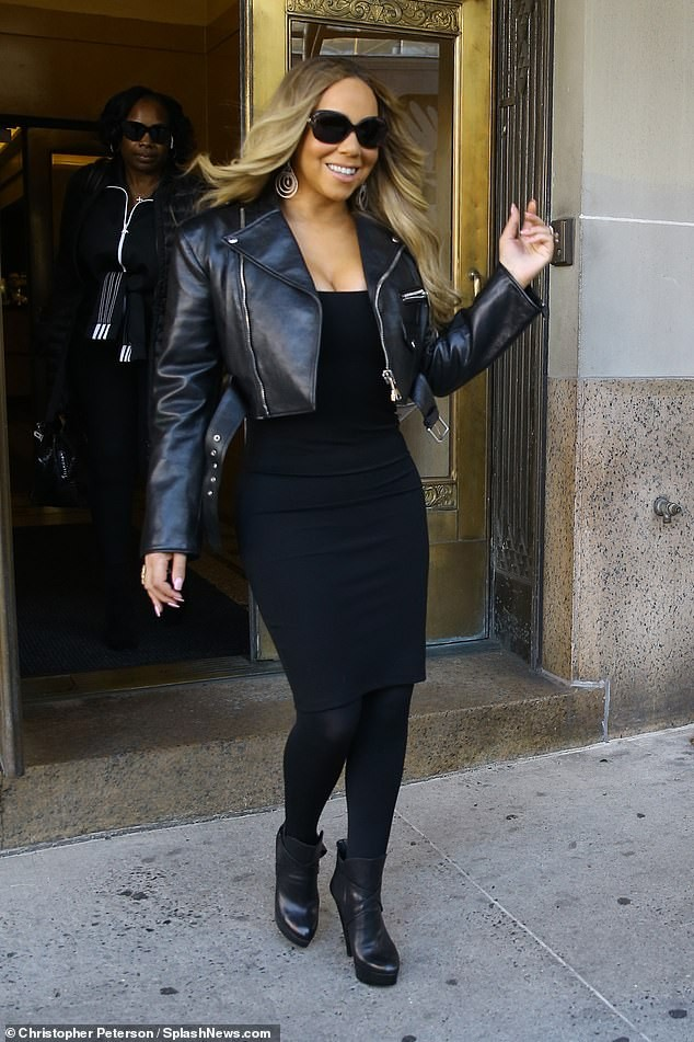 Mariah Carey flaunts her incredibly slender shape in figure-hugging black dress as she steps out in NYC?