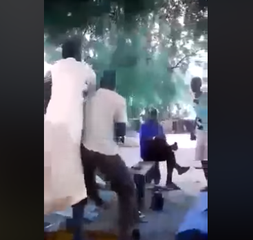 Two men come to blows while arguing over President Buhari (video)