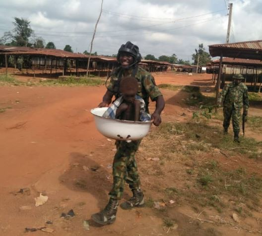 Soldiers rescue?an abandoned and malnourished child locked up in a house in Ebonyi State (Photos)