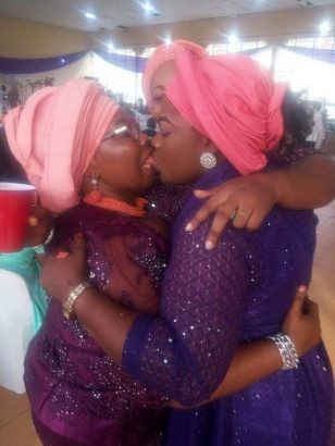 Viral photo of two Nigerian women publicly locking lips at a wedding this weekend