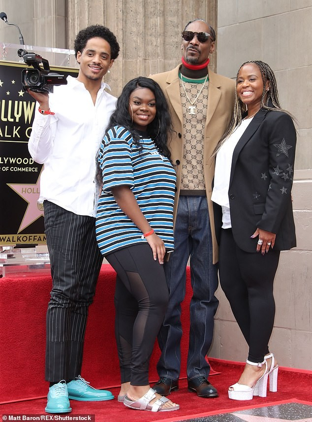 Snoop Dogg plants a sweet kiss on his wife of 21-years as he gets a star on Hollywood Walk of Fame (Photos)