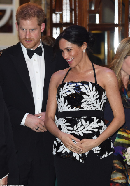 The pregnancy glow! Meghan Markle cradles her bump as she and Prince Harry enjoyed a night out (photos)
