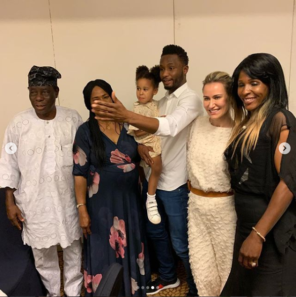 Adorable photos of Mikel Obi, his Russian partner and daughters as they visit his parents in Nigeria