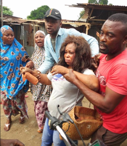 Suspected kidnapper is brutally beaten after she was allegedly caught trying to steal a 2-month-old baby (photos)