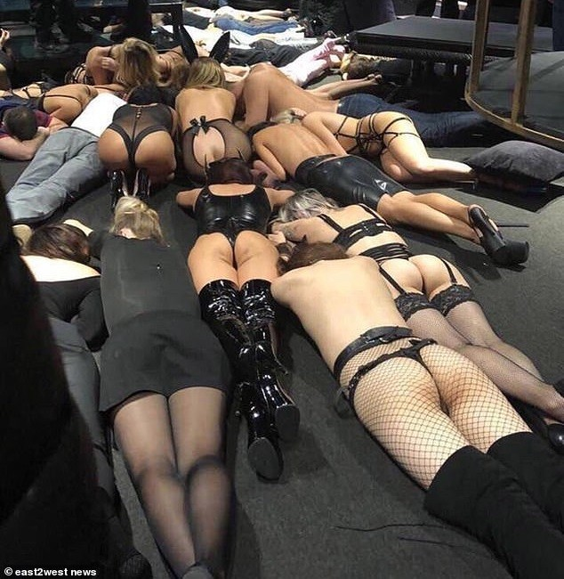 Video and photos show barely naked strippers on the floor as police carry out raid on