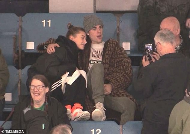 Justin Bieber and wife Hailey Baldwin cuddle up at a junior hockey game in Canada (Photos)
