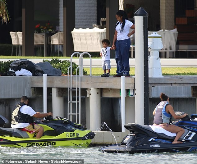 DJ Khaled and his wife Nicole Tuck ride jet skis around Miami on his 43rd birthday (Photos)