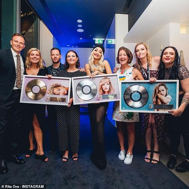 Rita Ora flashes her underwear in a sheer black dress as she celebrates receiving three ARIA Awards (Photos)