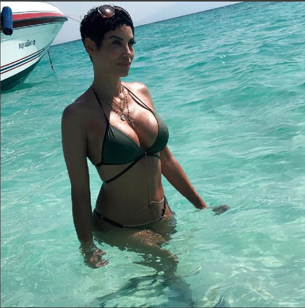 Mother of five Nicole Murphy,50, flaunts her banging bikini body as she vacations in Thailand (Photos)
