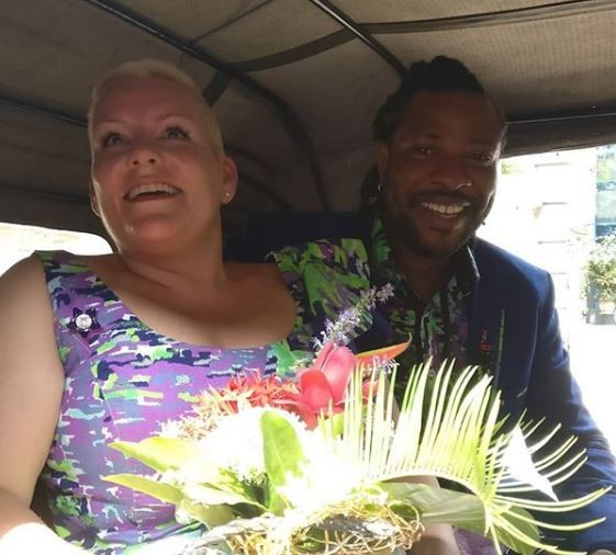 Lagos photographer, Bolaji Alonge and his Belgian fianc?e, Sandra wed with a convoy of 20 Keke Napeps (Photos)