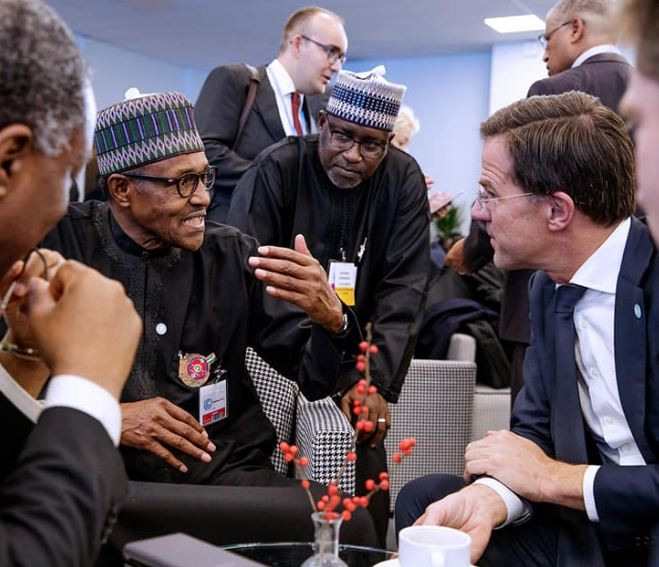 Caption this photo of President Buhari and the?Prime Minister of Netherlands,?Mark Rutte in Poland