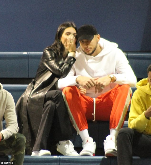 Kendall Jenner and her rumored boyfriend Ben Simmons cuddle up at a college basketball game (Photos)