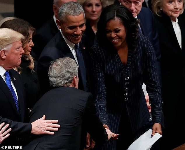 Adorable moment George W. Bush gave Michelle Obama candy just before his father
