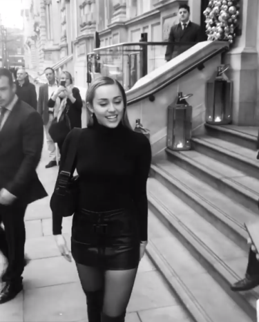 Braless Miley Cyrus steps out with her nipples on display (photos/video)