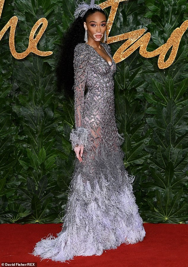 Model Winnie Harlow flaunts her stunning ?figure as she attends the British Fashion Awards in a beautiful feathered gown (Photos)