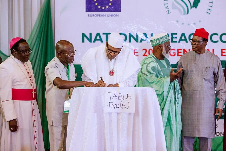 Photos: Atiku absent as President Buhari, other presidential candidates sign peace accord for peaceful election
