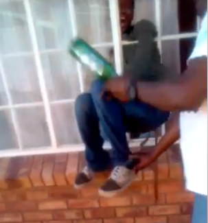Homeowner filmed beating a thief after the thief got stuck in window while trying to break into his house (video)