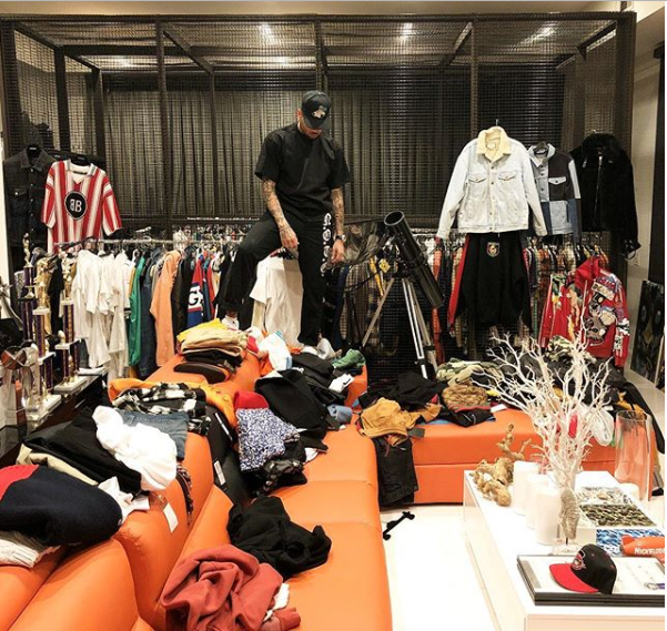Chris Brown shows off his walk-in closet as he complains he