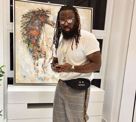Photos: Timaya spoils himself with a G-Wagon and a Maybach for Christmas