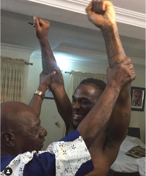 Viral photo of Burna Boy?s grandfather who used to manage Fela showing him how to properly do his signature pose?