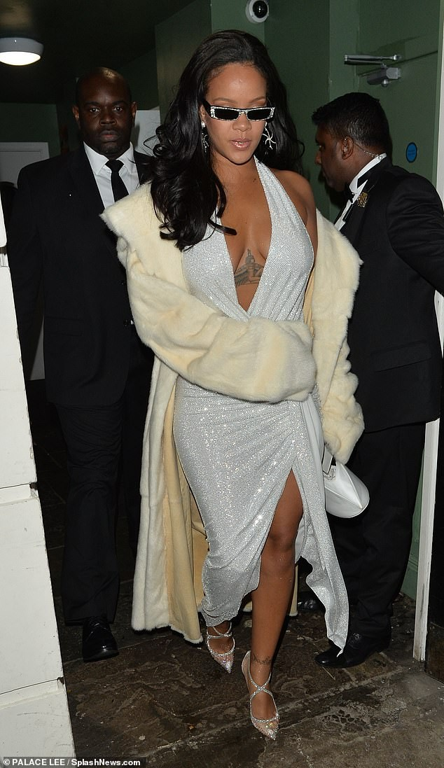 Rihanna goes braless in plunging silver dress for New Year