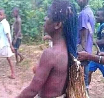 Outrage as Anambra residents strip lady naked over N2000 stolen chicken (photos)