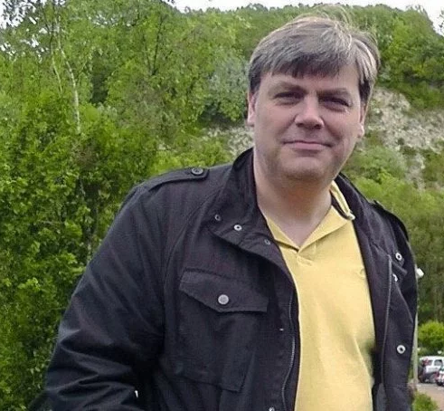 Photo of man stabbed to death in front of son on train from Gilford to London