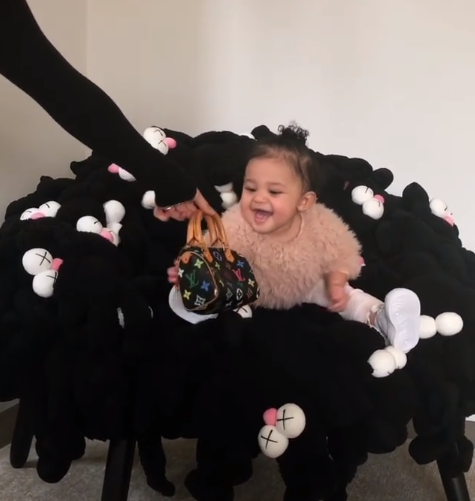 Check out 11-month-old Stormi Webster rocking the 1100 LV bag her aunt Kim Kardashian bought for her