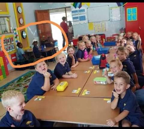 Growing outrage over disturbing photo of black pupils allocated a table away from their white classmates in South Africa