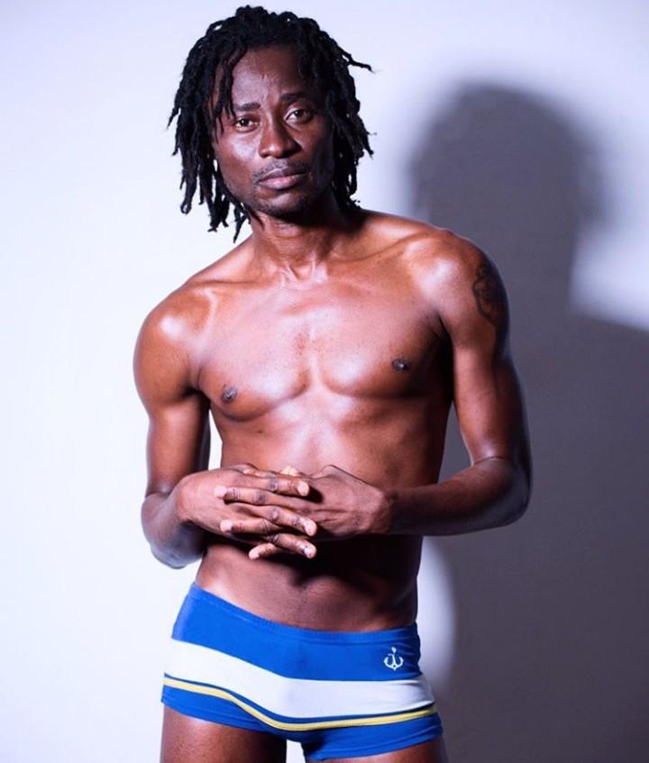 Bisi Alimi pictured in just his underwear
