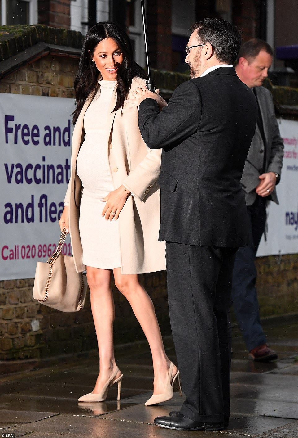 Meghan Markle opts for head-to-toe cream as she visits a London animal charity she is now supporting as patron