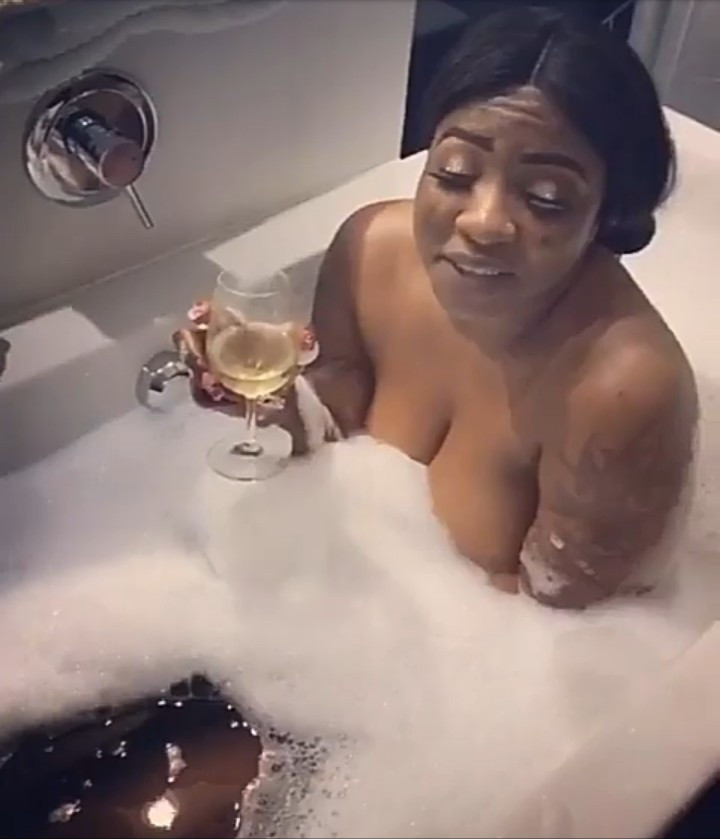 "Anita Joseph shares risque clip of herself naked in a bathtub with a man as she tells followers who have a problem with it to ""f*** ya sef"""