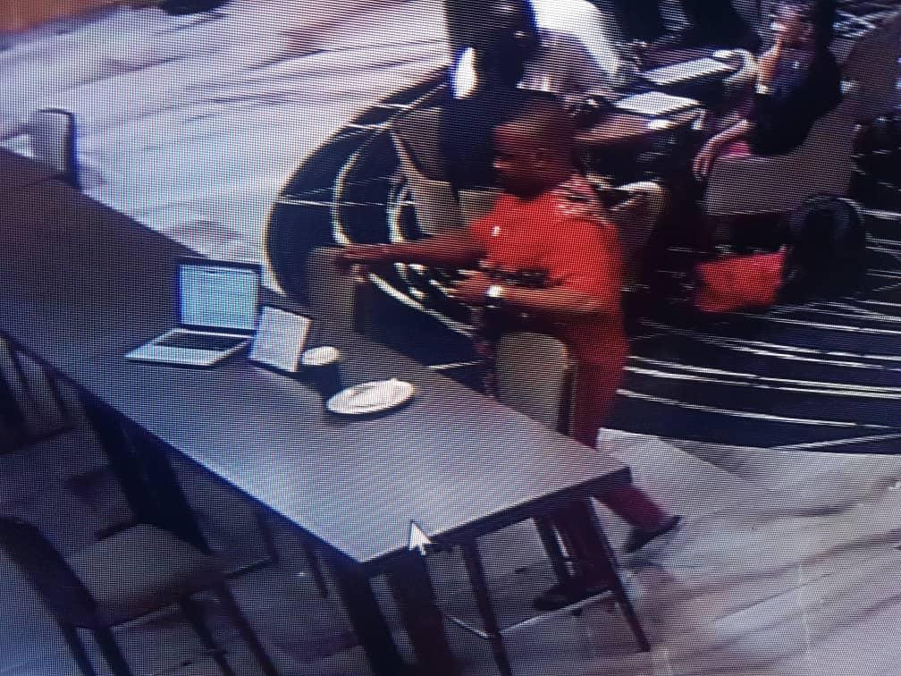 Photos/Video: Suspected thief caught on camera stealing the Macbook of a guest at Radisson Blu Hotel