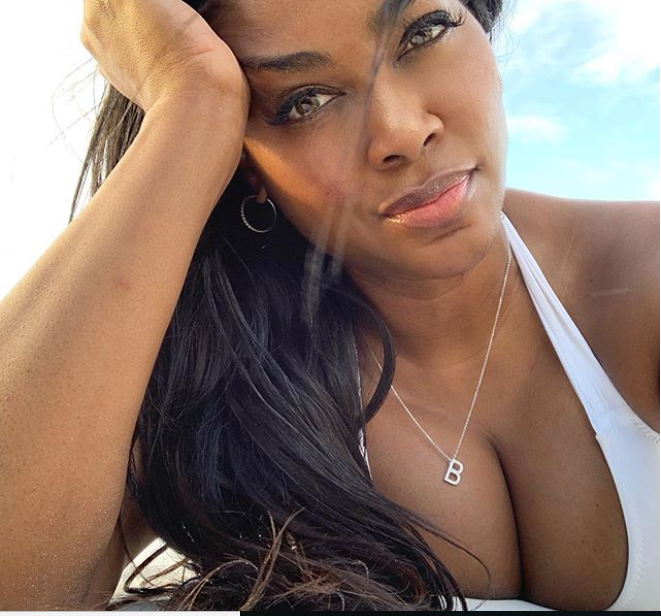 Bikini-clad Kenya Moore flaunts her banging body as she celebrates 48th birthday with her daughter at the beach (Photos)