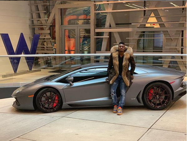 Nigerian footballer, Obafemi Martins shows off his new whip Ferrari Spider