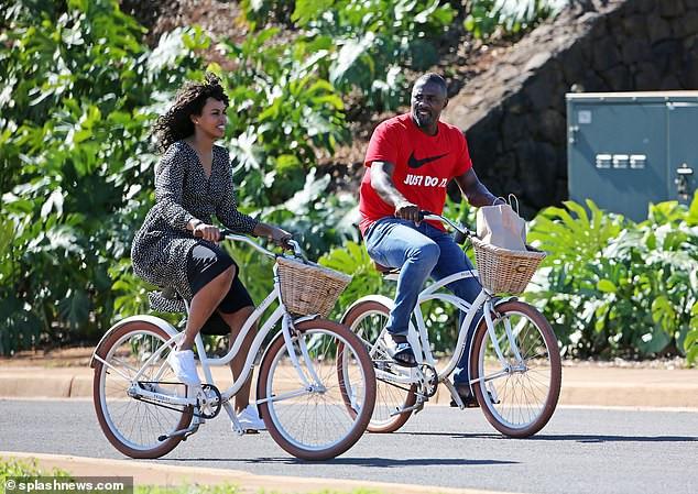 Idris Elba enjoys a romantic bike ride with his stunning fianc?e Sabrina Dhowre during their Hawaii break (Photos)
