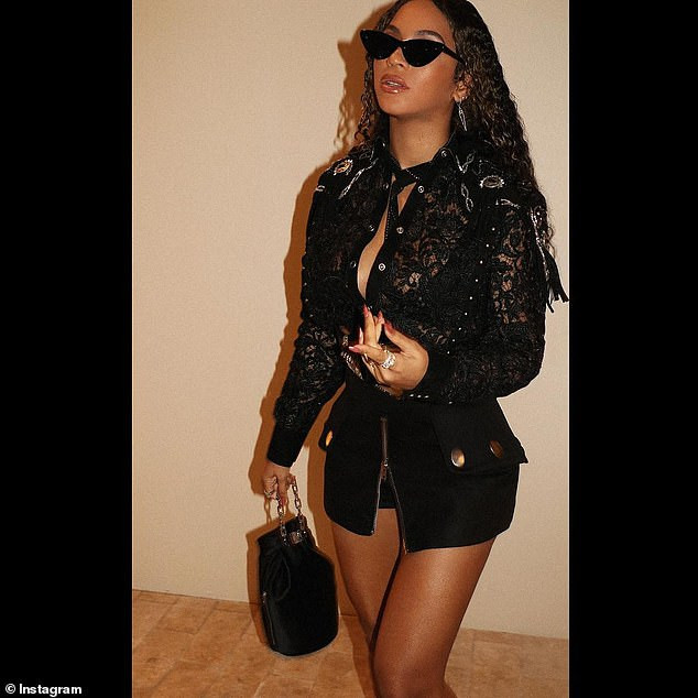 Beyonce flaunts her backside in stylish black lace top and skimpy mini skirt (Photos)