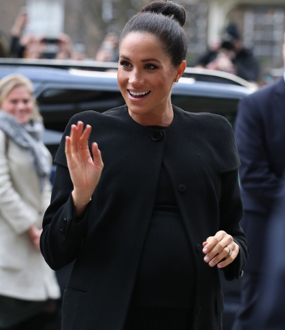 Meghan Markle steps out looking regal in a sleek topknot and an all-black outfit (photos)