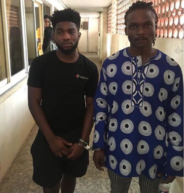 Man alleged to be the father of Lekki hotel rape suspect is seen protecting his son as the suspects were being arrested (video)
