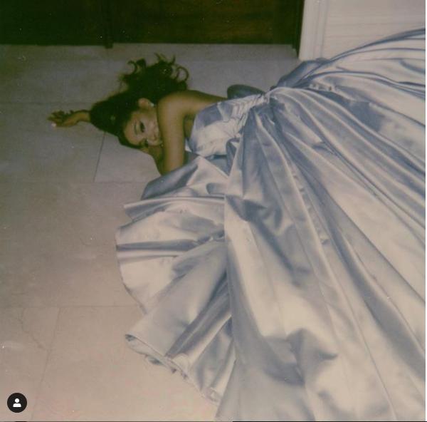 Ariana Grande wears her Grammy